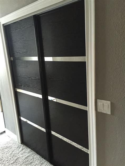 Adhesive Door Mirror - updated some dated mirror closet doors with wood grain