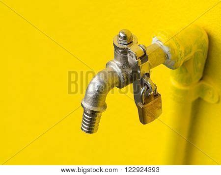 yellow faucet on yellow wall image photo bigstock