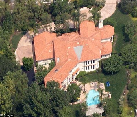 kris jenners address kris jenner wants kim and kanye to move into her mansion