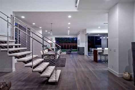 modern great room with chandelier hardwood floors in los