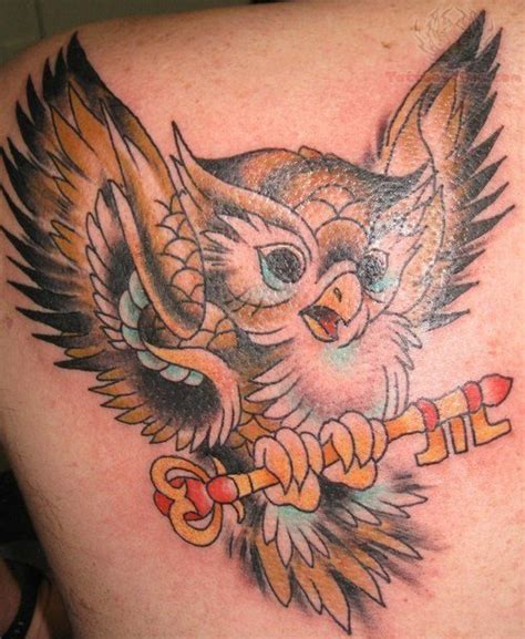 flying owl tattoo flying owl with key
