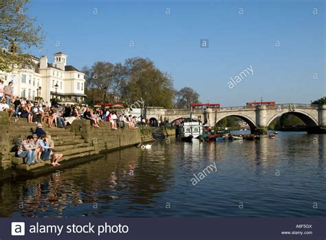thames riverside people relaxing on the riverside of the river thames