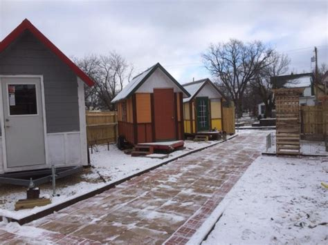 new tiny house neighborhood will allow homeless to rent to own tiny house community for homeless finishes 3rd tiny home