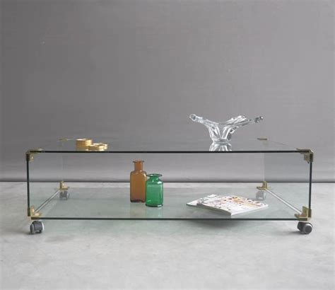 glass coffee table with wheels large glass and brass coffee table on wheels 1970s for