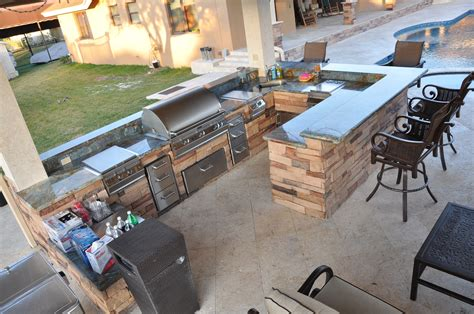 custom backyards firemagic built in bbq and gas fire pit custom built with blue granite and natural