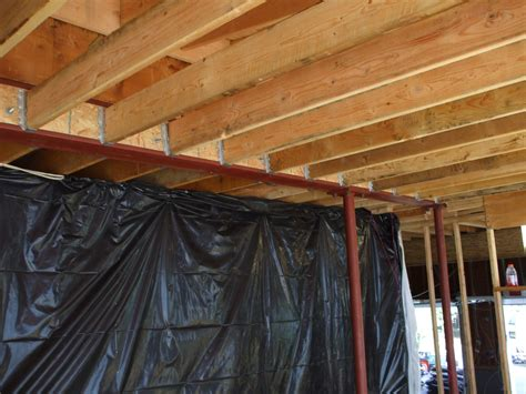 steel ceiling joists attaching 2x6 ceiling joists to steel beam web blocking