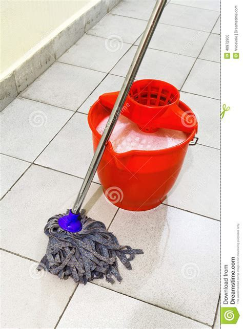 Red Bucket With Washing Water And Mop The Floor Stock