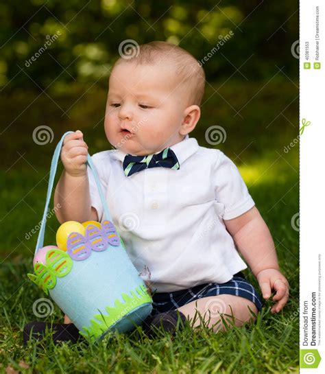 easter for boy infants infant baby boy with easter eggs and basket stock