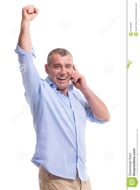 casual chic for middle age casual middle aged man on phone and cheering stock image