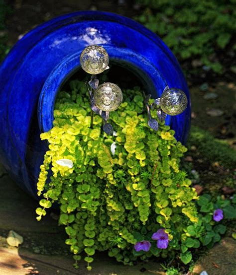 10 Planters That Will Spill Fragrant Flowers Into Your