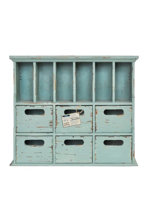 teal cabinet with cubbies want storage