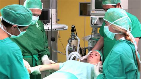c section doctor surgical team performing caesarean section in operation