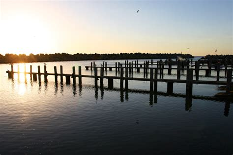 fishing ocean reef boat harbour the jetties at sunset this photo is in fact level the