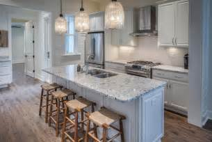Traditional kitchen with flush light bianco frost granite countertop