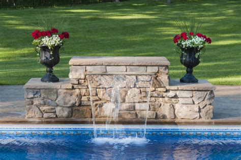 how to build a waterfall into a pool how to build a wall with sheer decent waterfall