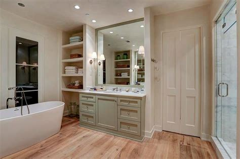 bathroom alcove shelves oval freestanding tub in front of french doors cottage bathroom