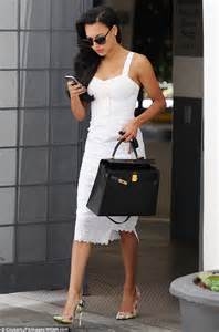 naya rivera dons white lace dress for business meeting in