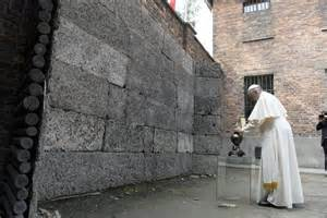 Pope francis pays respects by the death wall in the former nazi german