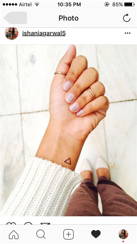 tattoo placement wrist meaning hello tiny tattoo with big meaning triangle tattoo i got