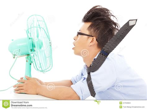 fan that blows cool air summer heat business man use fans to cool down stock