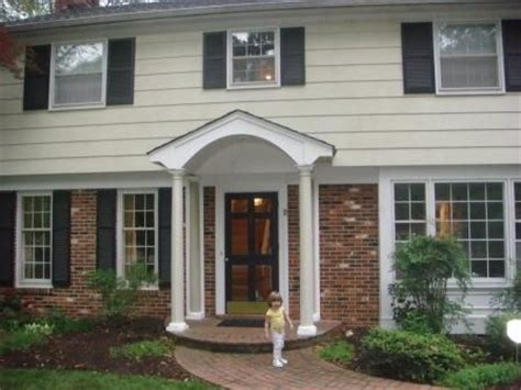 portico on colonial house portico added to update garrison style home curb appeal