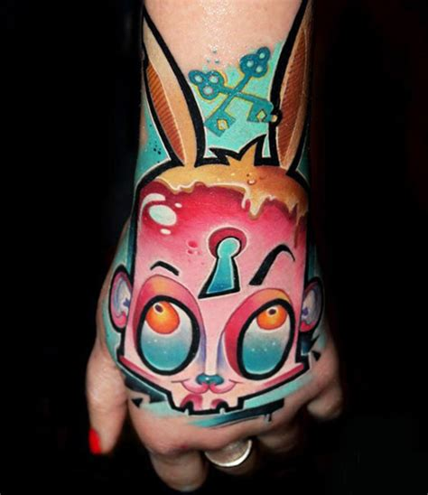 tattoo hand new school new school style behind the vivid colors