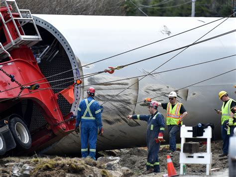 wind after c section crew removes massive wind turbine tower section from