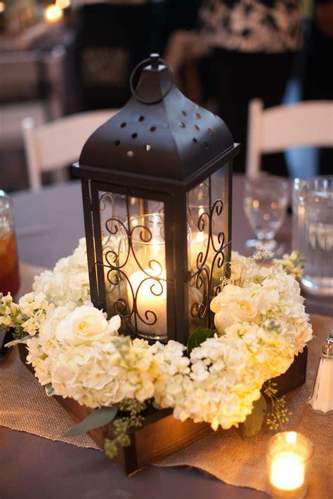 black and white table centerpieces black lantern and white hydrangea centerpiece wedding