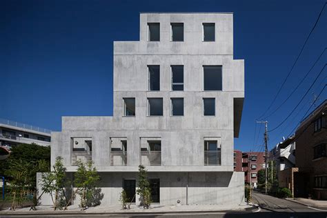 concrete apartments hiroyuki ito completes staggered concrete apartment