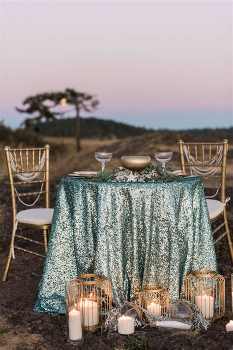 glam mermaid wedding on the moonlit coast sweetheart table mermaid and aqua