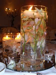 candle centerpieces for wedding reception bowl filled with pink lotus and floating candles for