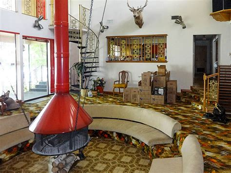 sunken 70s living room with floating fire place adrift on