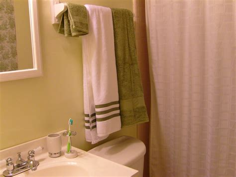 where to hang towels in a small bathroom how to fold towels keep them hanging straight in your