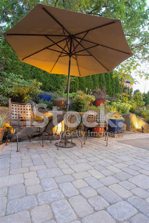 patio table and chairs with umbrella garden patio table and chairs with umbrella stock photos