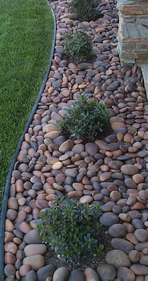 25 best ideas about river rock landscaping on