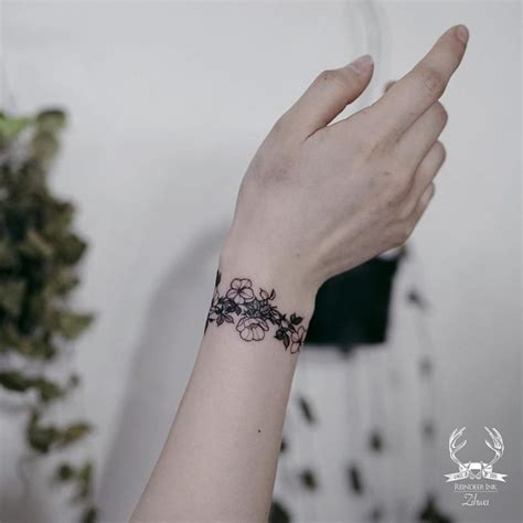 flower bracelet tattoo designs best 25 wrist bracelet tattoos ideas on