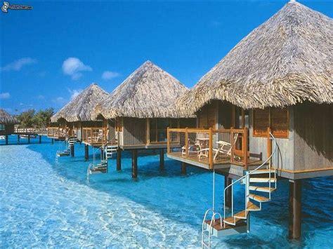 tiki hut vacations on the water seaside bungalows on bora bora
