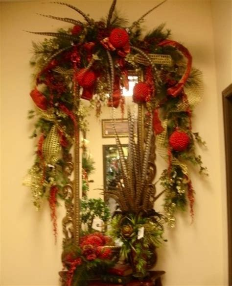 red and gold christmas garland over wall mirror a