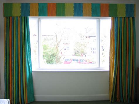Interlined and blackout curtainsand pelmet in Designers Guild fabric