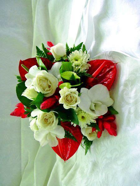 destination wedding bouquet composed of traditional jamaican wedding bouquets boutonnieres