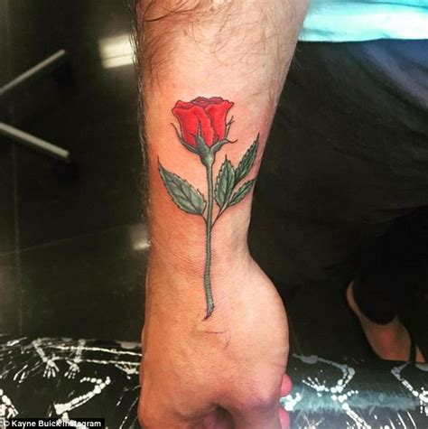 the bachelorette s kayne buik gets rose tattoo after being