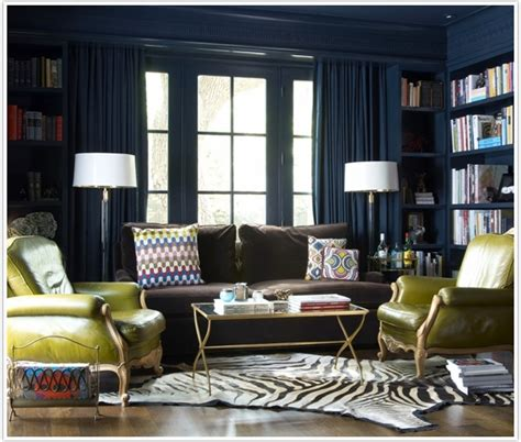 blue walls in living room bring it home moody blue bookshelves camille styles