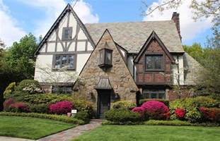 ordinary Exterior Designs For Small Houses #6: Awesome-tudor-house-style-with-red-brick-and-crumbling-stone-wall-ideas-and-with-awesome-flower-garden-in-front-of-house.jpg