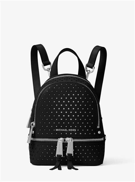 michael kors rhea mini perforated leather backpack in black lyst