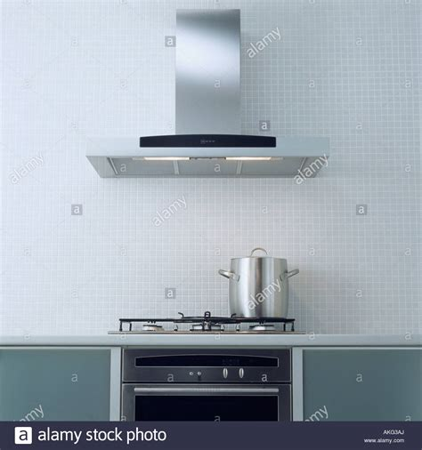 modern kitchen extractor fans stainless steel extractor fan above pan on hob in modern