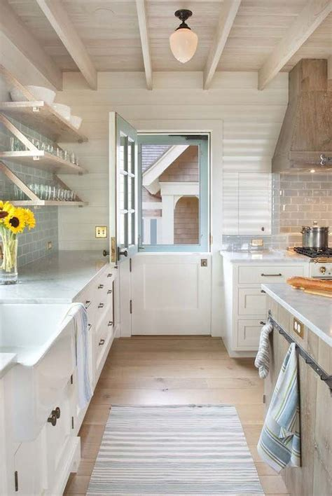 dutch door into kitchen in contrasting color and painted ceiling top 15 interior door projects that belong in a magazine