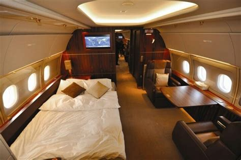 a bed of a private jet interior and exterior pinterest