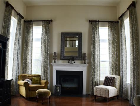 Two Story Living Room Curtains by Two Story Drapes With Decorative Wood Poles