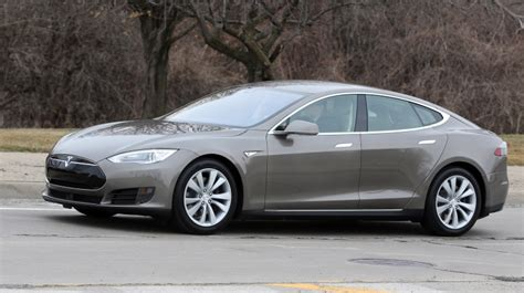 Lower Cost Tesla Tesla Rolls Out All Electric Sedan With Lower Price