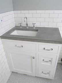 white subway tile wall concrete counters white